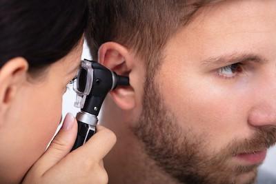 examining earwax